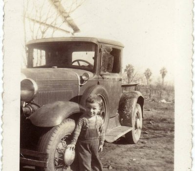 Pictured with the car is John's cousin, Leonard (1940).